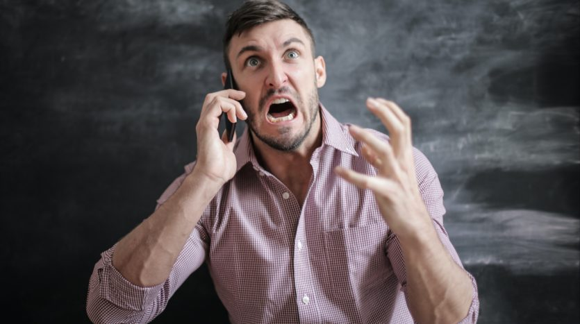 Frustrated man trying to buy a home.