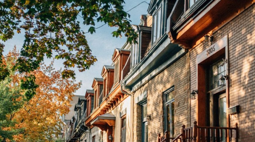 Row of townhomes on a street.