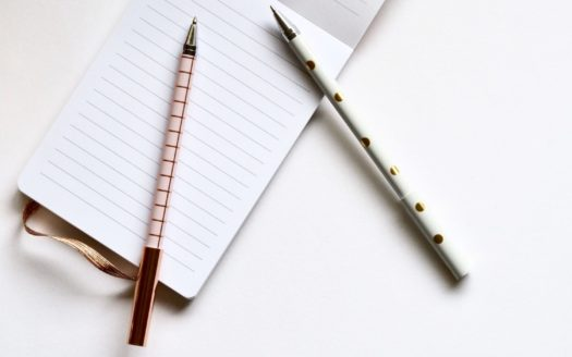 Pen and opened lined notepad.